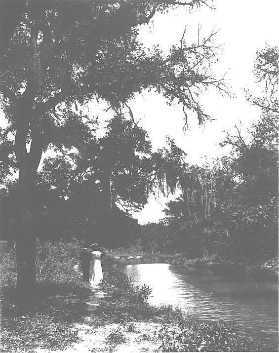 Couple walking along Shoal Creek